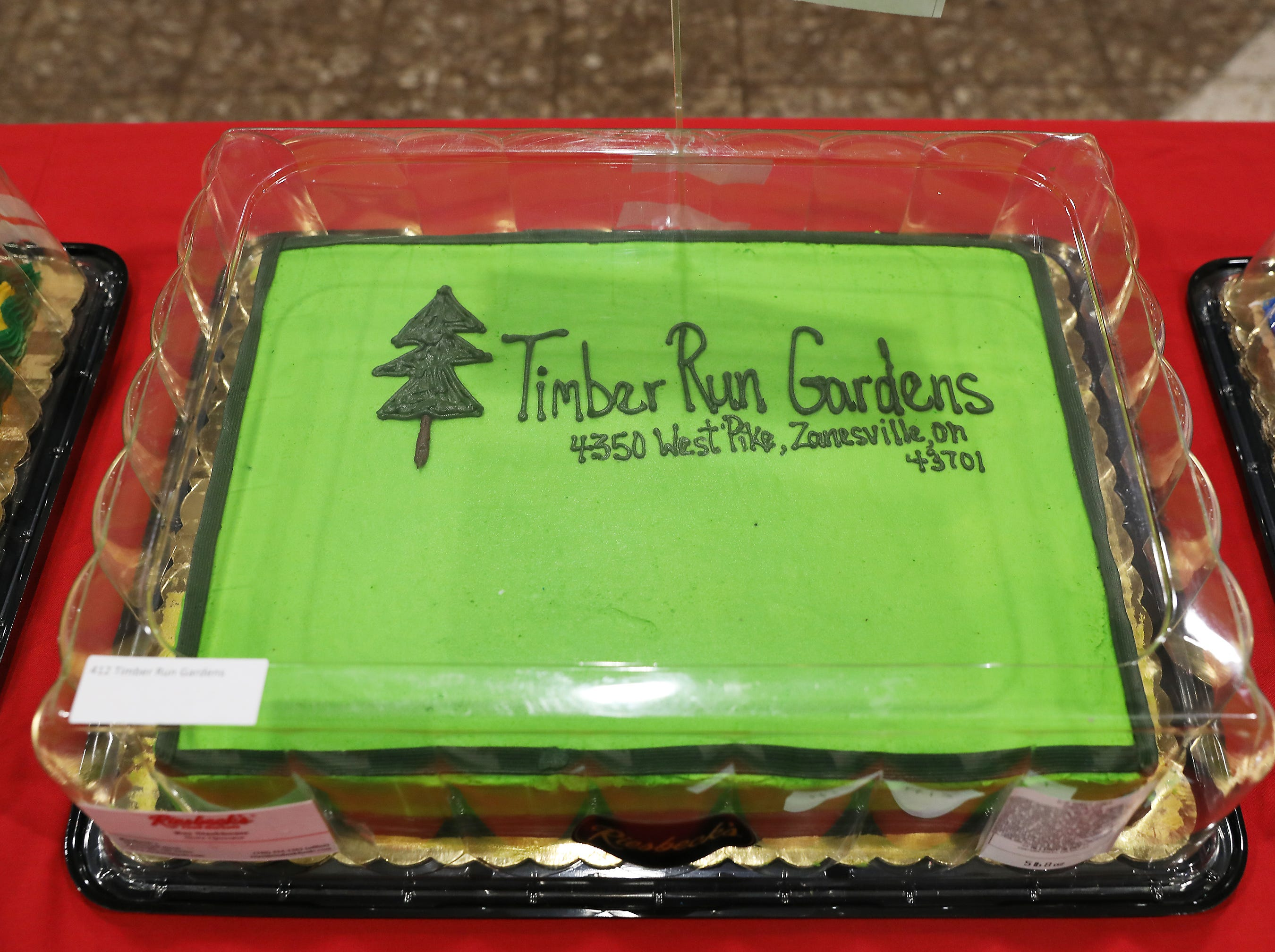 5:45 P.M. Friday cake 412 Timber Run Gardens - spring package 1 flat of vegetables, apple tree, week preventer, mulch; mid Spring package, large hanging basket, 10 geraniums, 5 perennials, 2 roses, 1 deer repellent; fall package 10 mums, 5 asters, 1 red maple; Christmas package 1 poinsettia, 1 6-8' frazier fir; $700