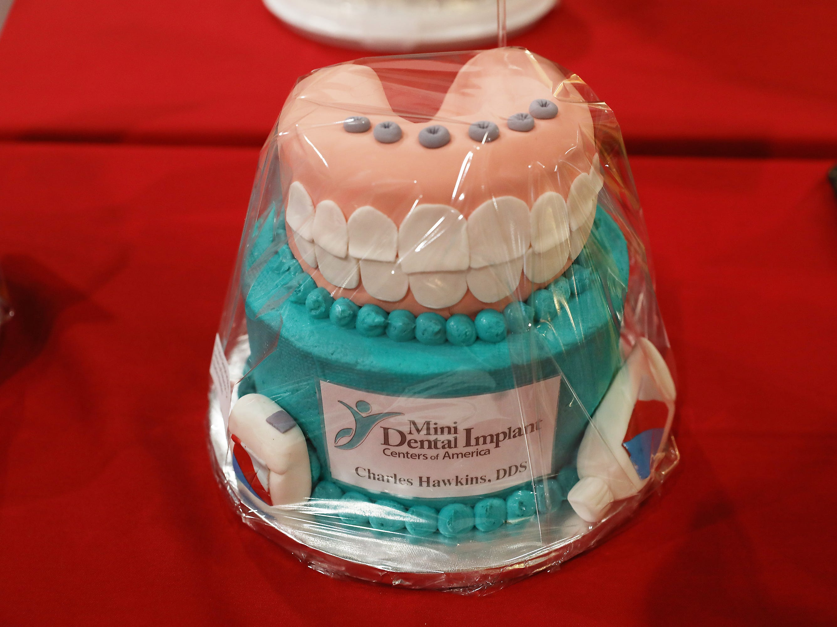 Friday 1:45 P.M. Friday cake 323 Mini Dental Implant Centers of America - at home whitening kit, discount on implant; $199