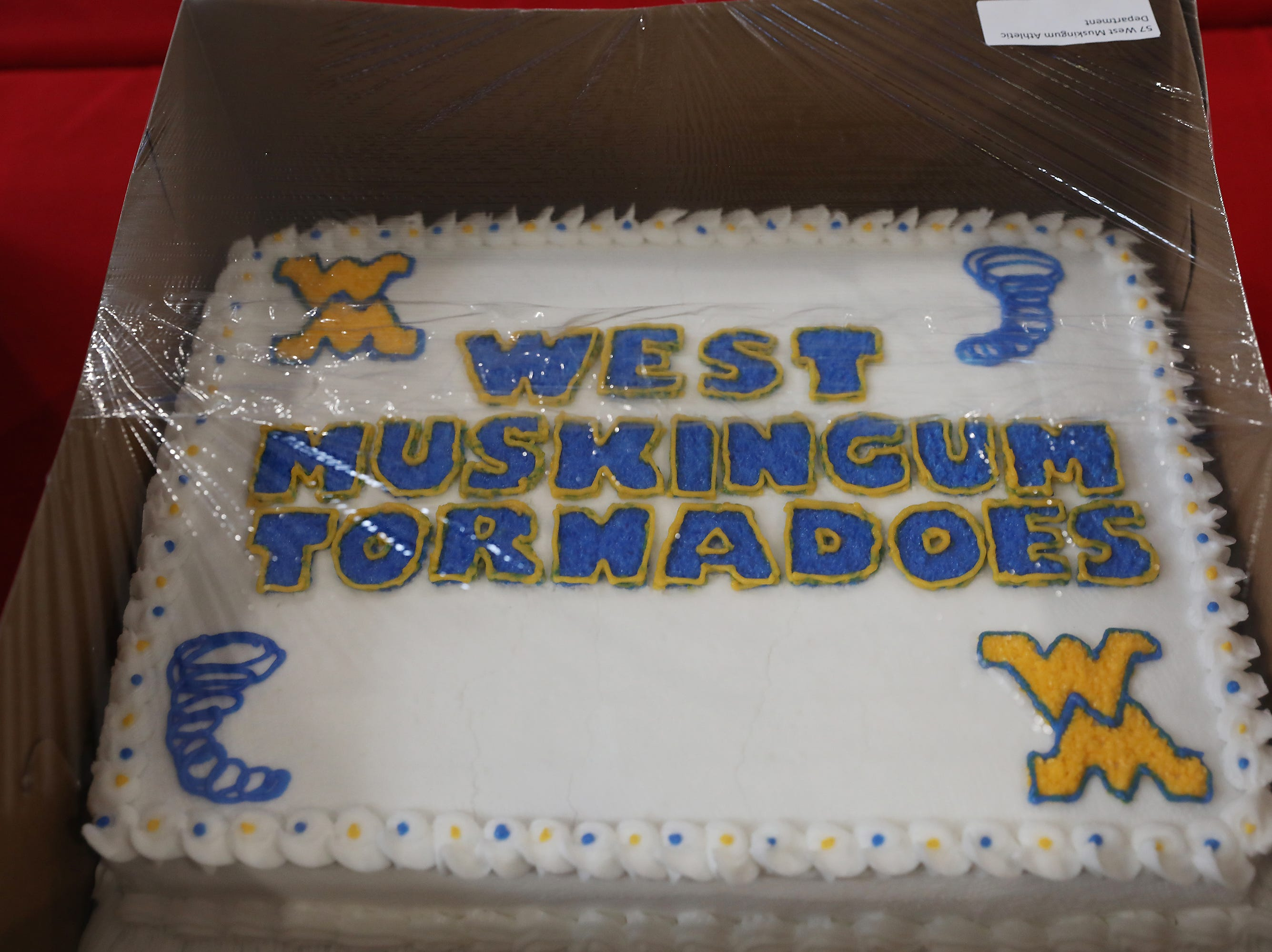 10:30 A.M. Thursday cake 57 West Muskingum Athletic Department - 2 adult full year athletic passes: $150