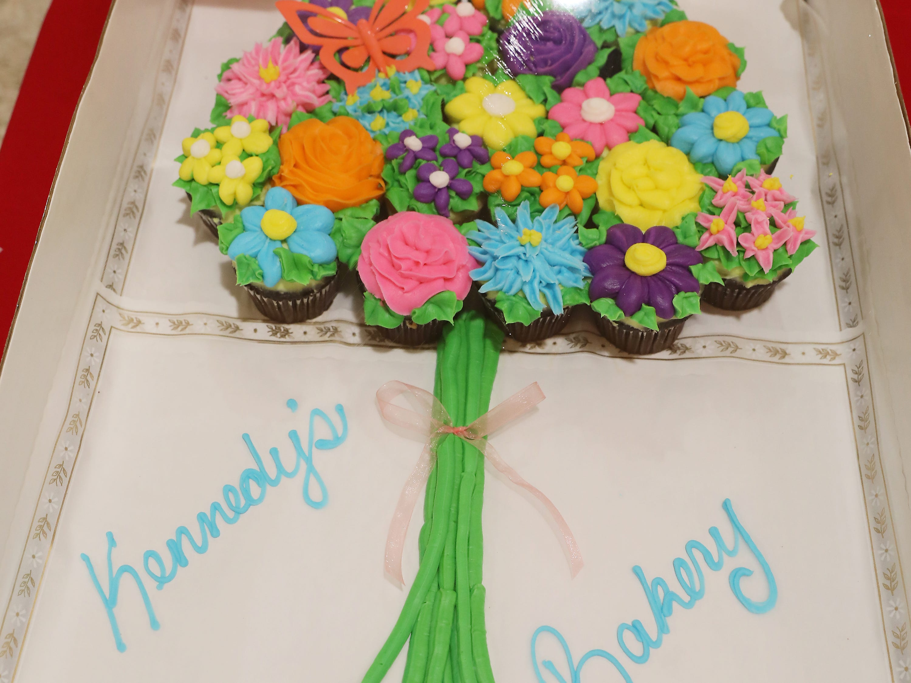 9:15 A.M. Friday cake 234 Kennedy's Bakery - $25 to Kennedy's