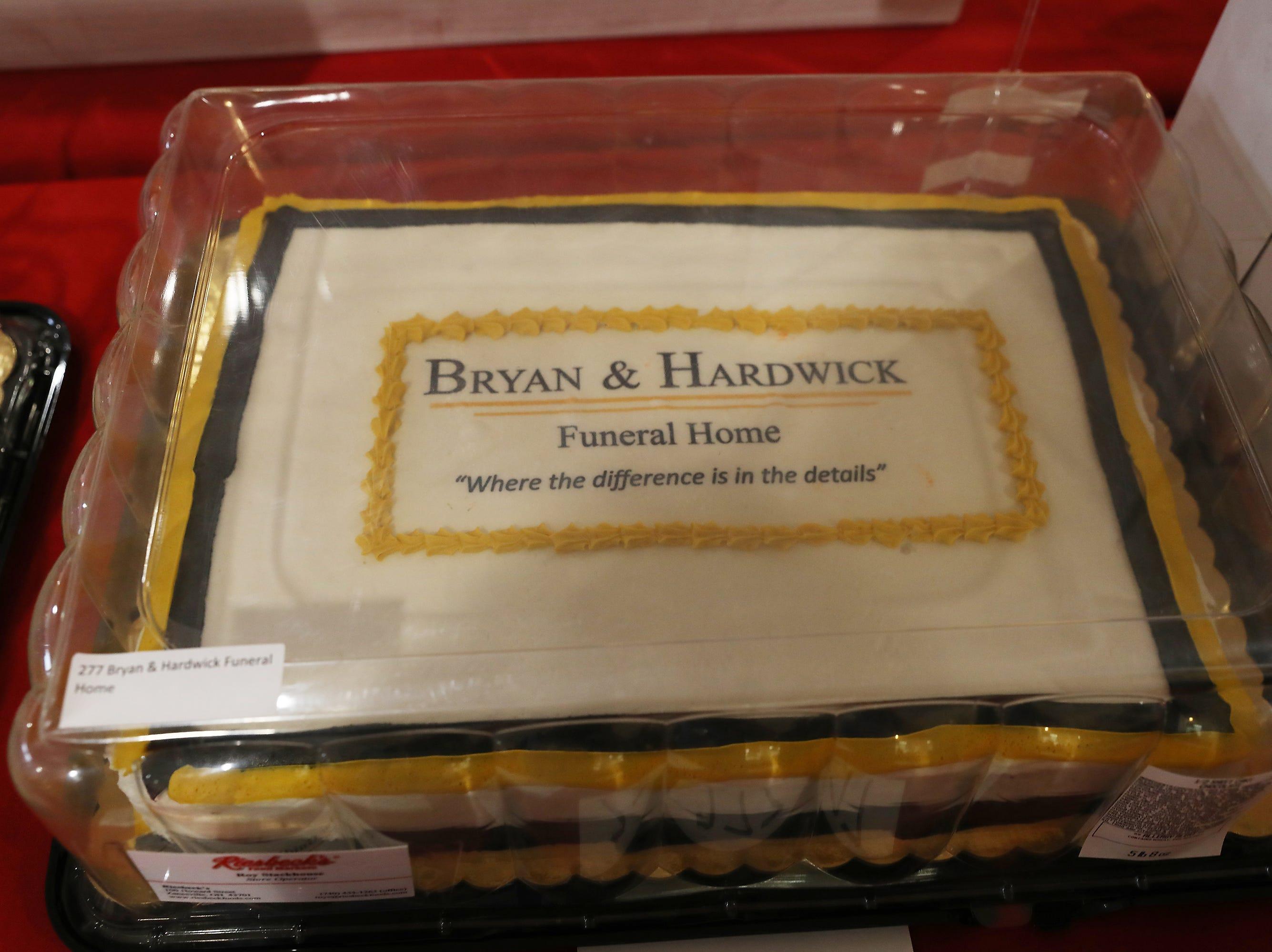 11 A.M. Friday cake 277 Bryan & Hardwick Funeral Home - $100 Adornetto's gift card, $100 Winerak, print of Zanesville