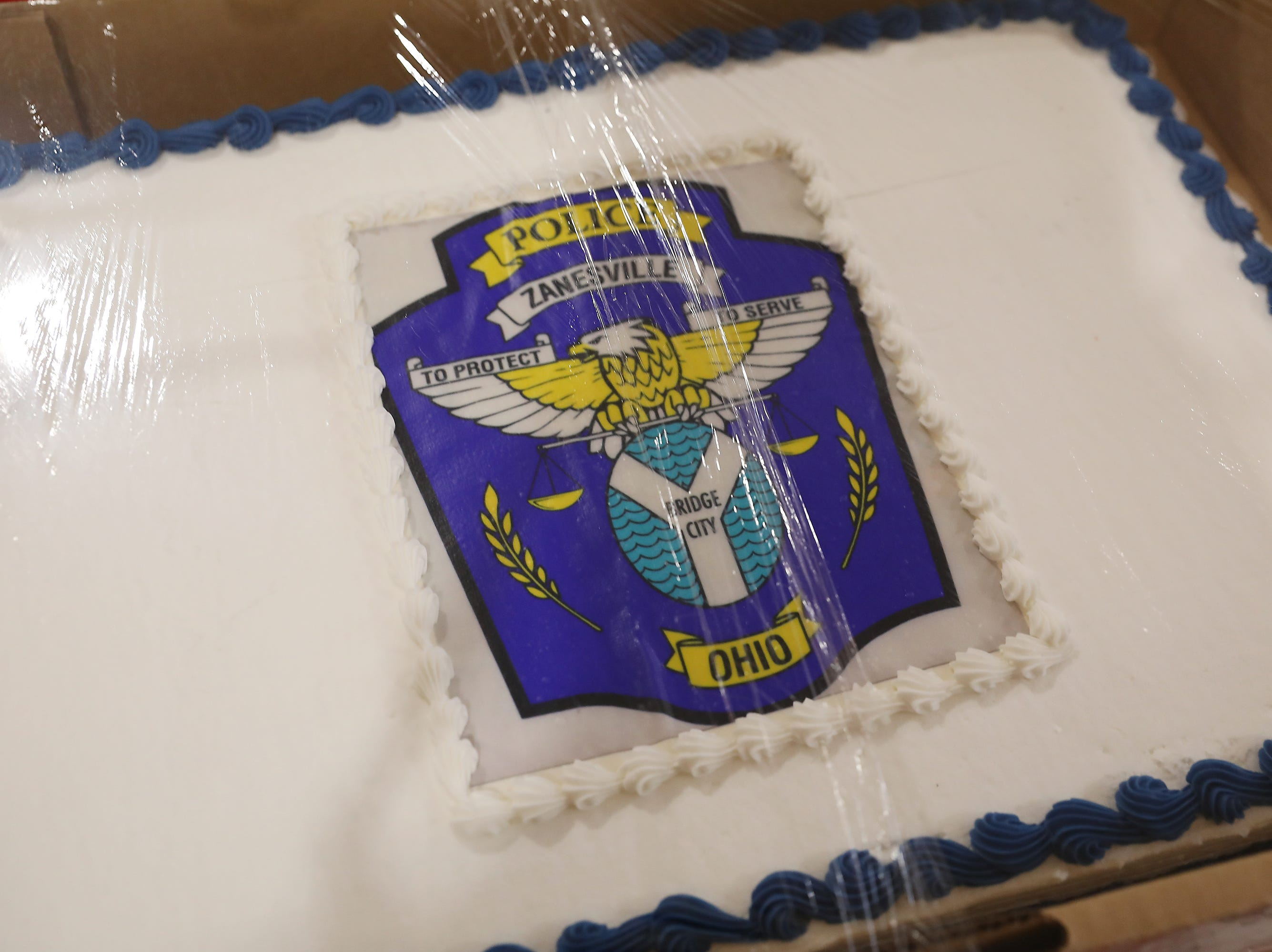 3 P.M. Friday cake 352 Zanesville Police Department - ride to school or K9 Demo, discount on Imperial Storage rental fee,  Amish basket with local items