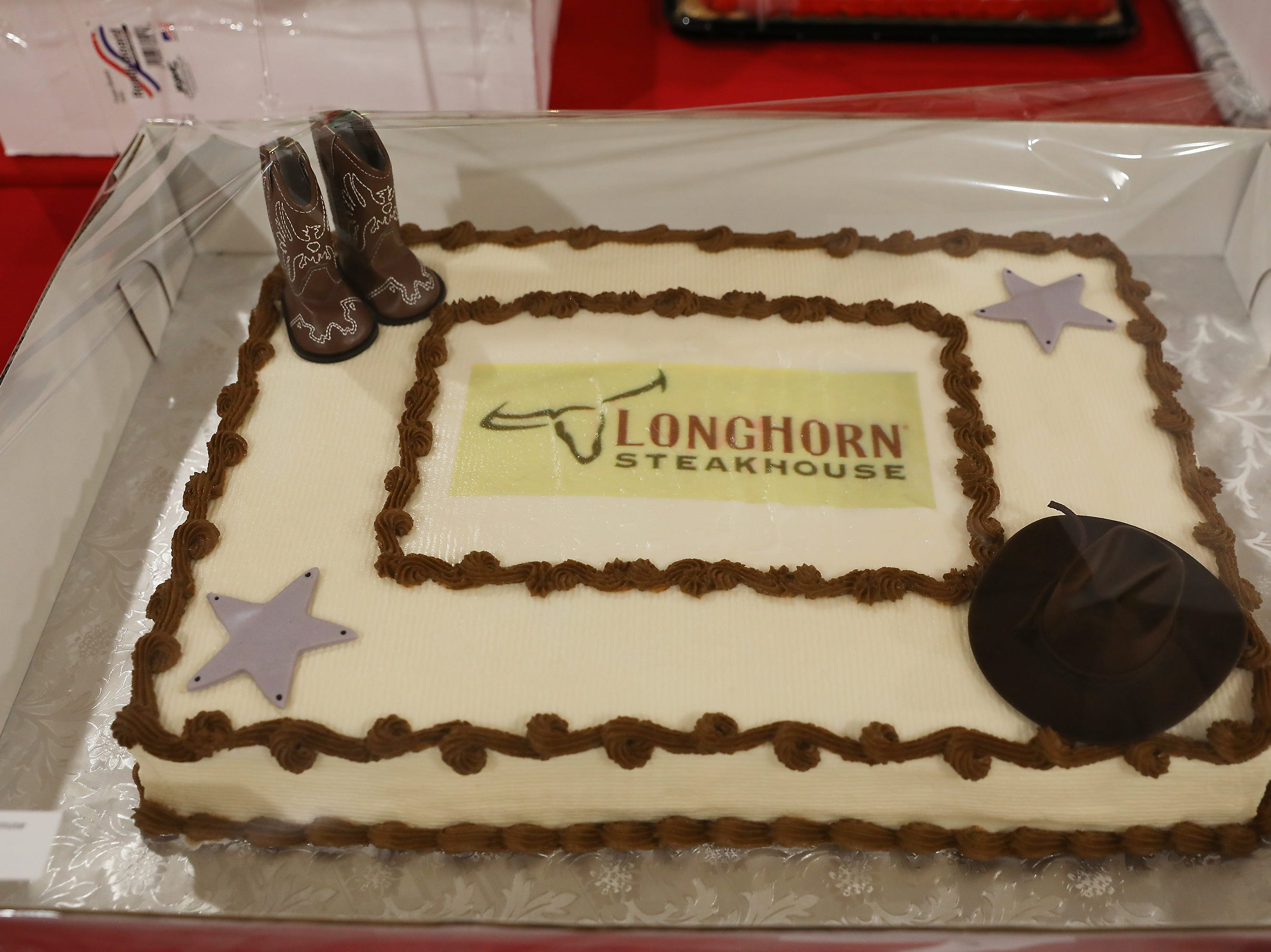 1:15 P.M. Thursday cake 101 Longhorn Steakhouse -  wine and gift cards