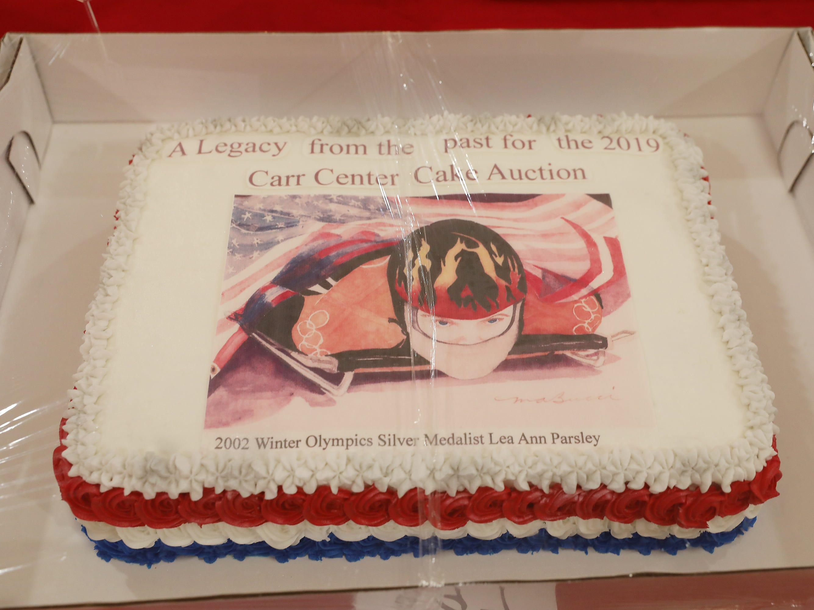 12:45 P.M. Friday cake 297 Mary Ann Bucci -  print of Lea Ann Parsley, 2002 Winter Olympics Silver Medalist by Mary Ann Bucci, signed by her and Lea Ann; $125.