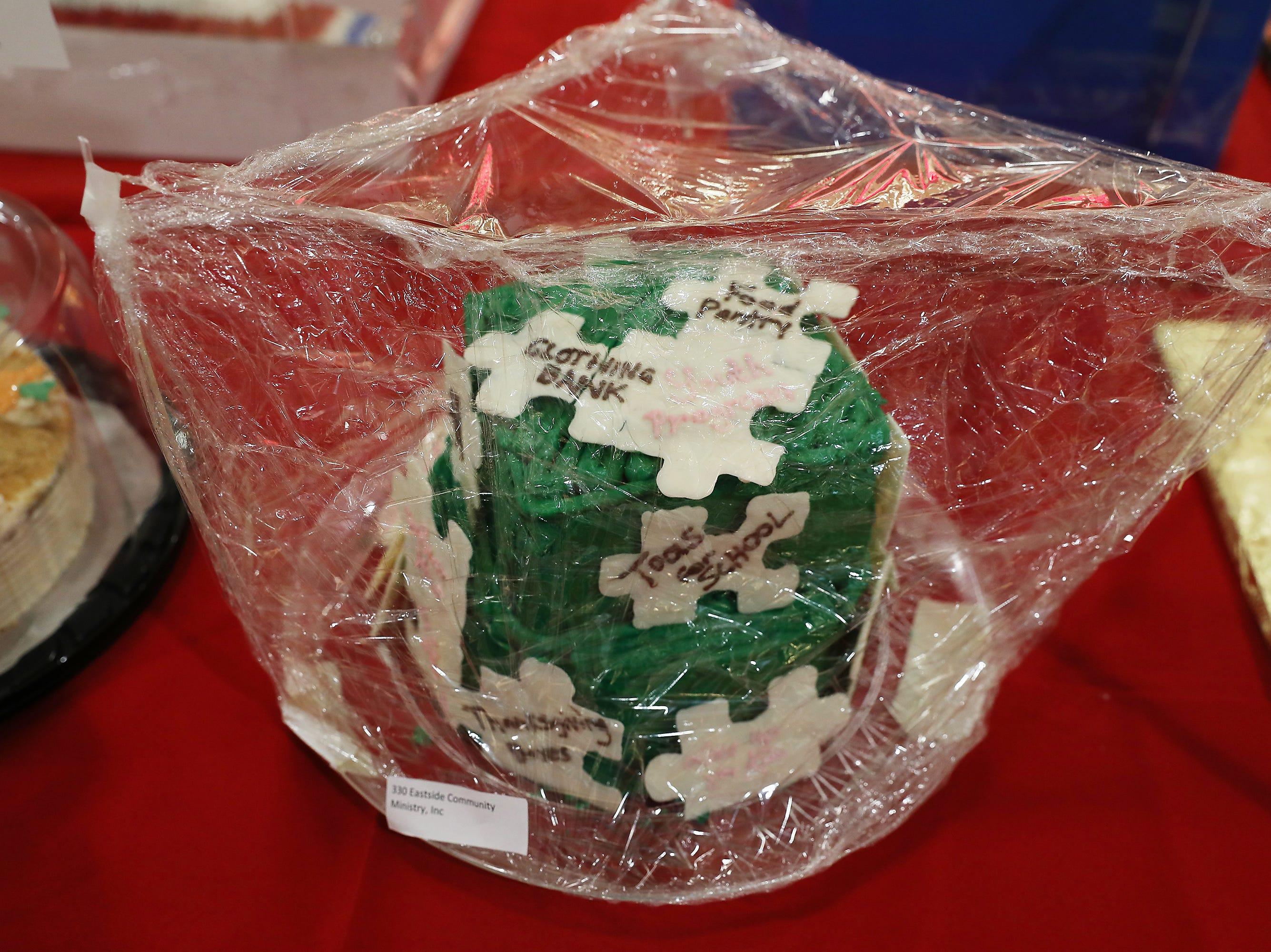 2:15 P.M. Friday cake 330 Eastside Community Ministry - Six custom Eastside puzzles; $100