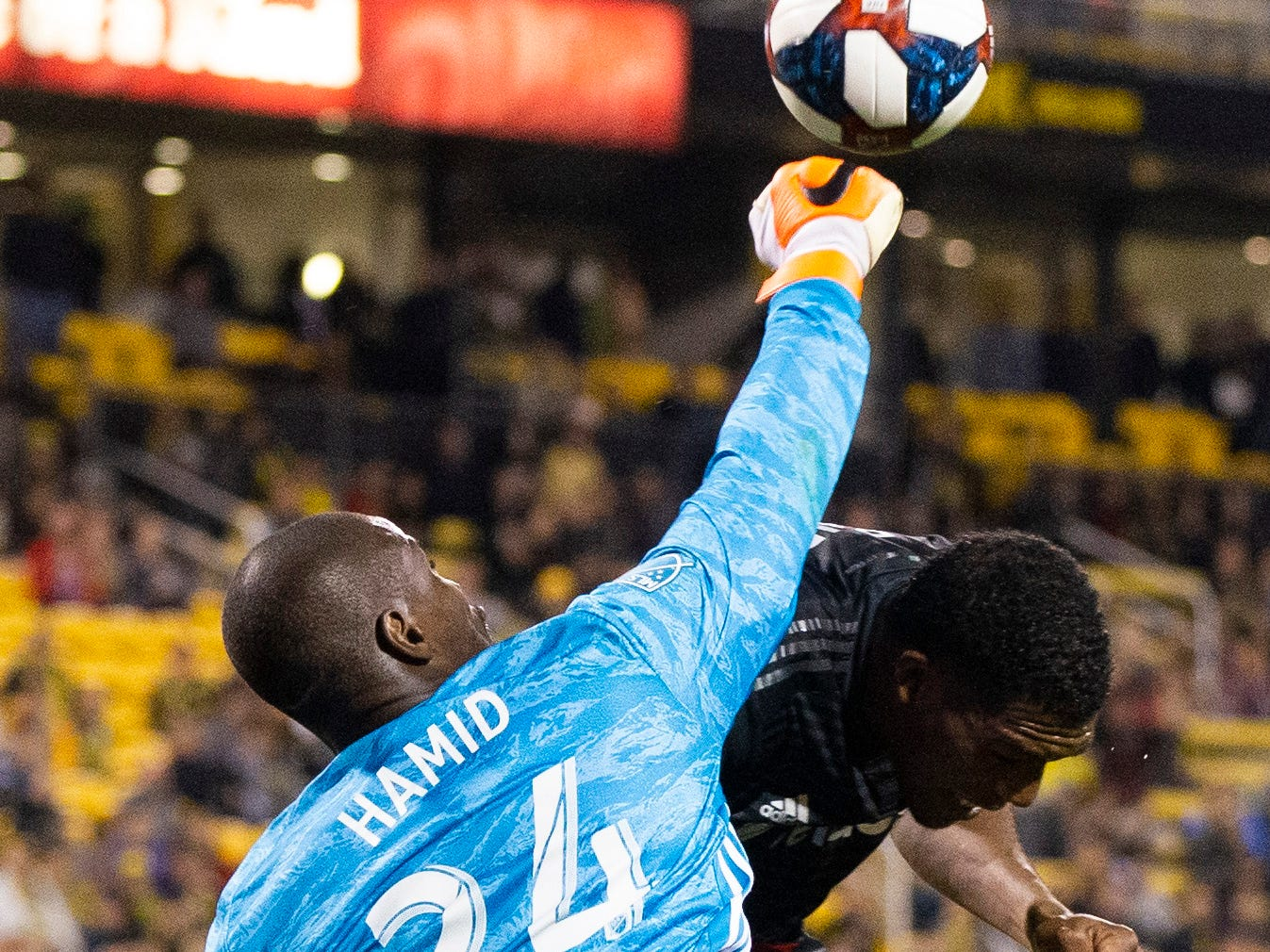 April 24: D.C. United goalkeeper Bill Hamid (24) punches the ball away against Columbus Crew SC during the second half at MAPFRE Stadium. D.C. United won the game, 1-0.
