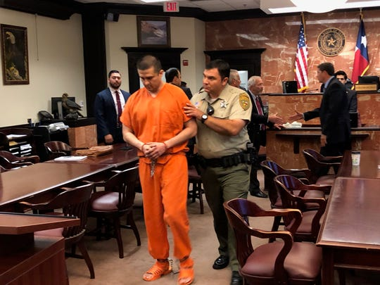 Juan David Ortiz is led from the courtroom on April 25, 2019, by a Webb County Sheriff's deputy. Ortiz, a former Border Patrol agent, is accused of killing four women in the Laredo, Texas, area last year. He faces the death penalty if convicted.