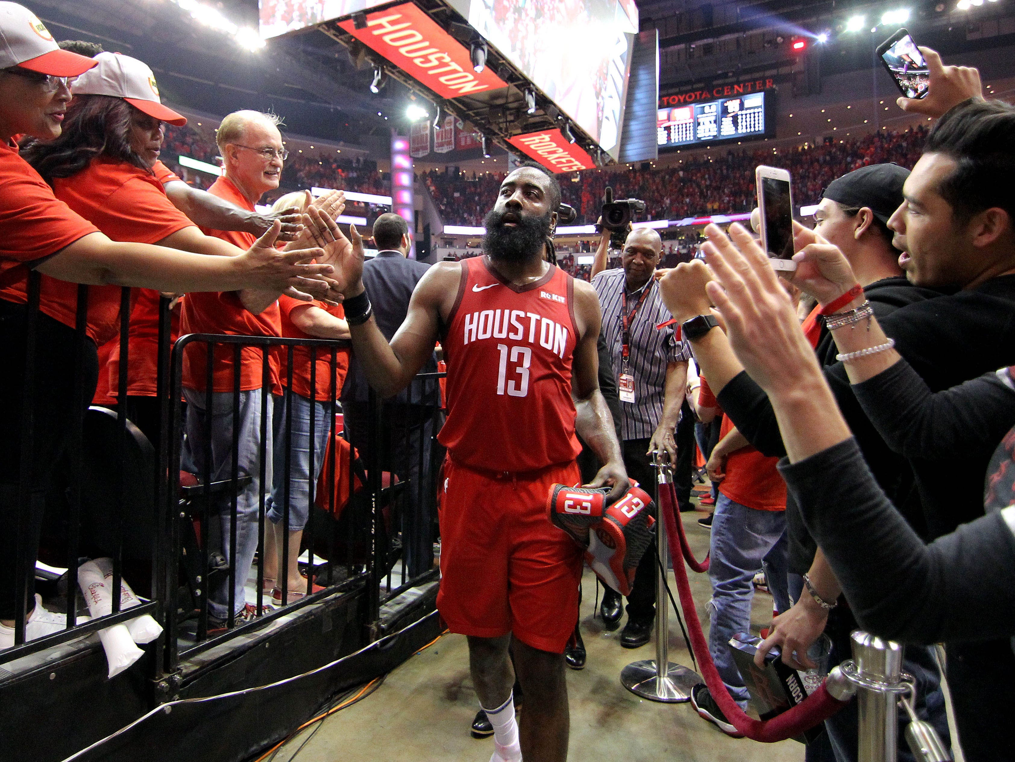 April 24: Rockets guard James Harden celebrates with fans as he leaves the floor after eliminating the Jazz in Game 5.