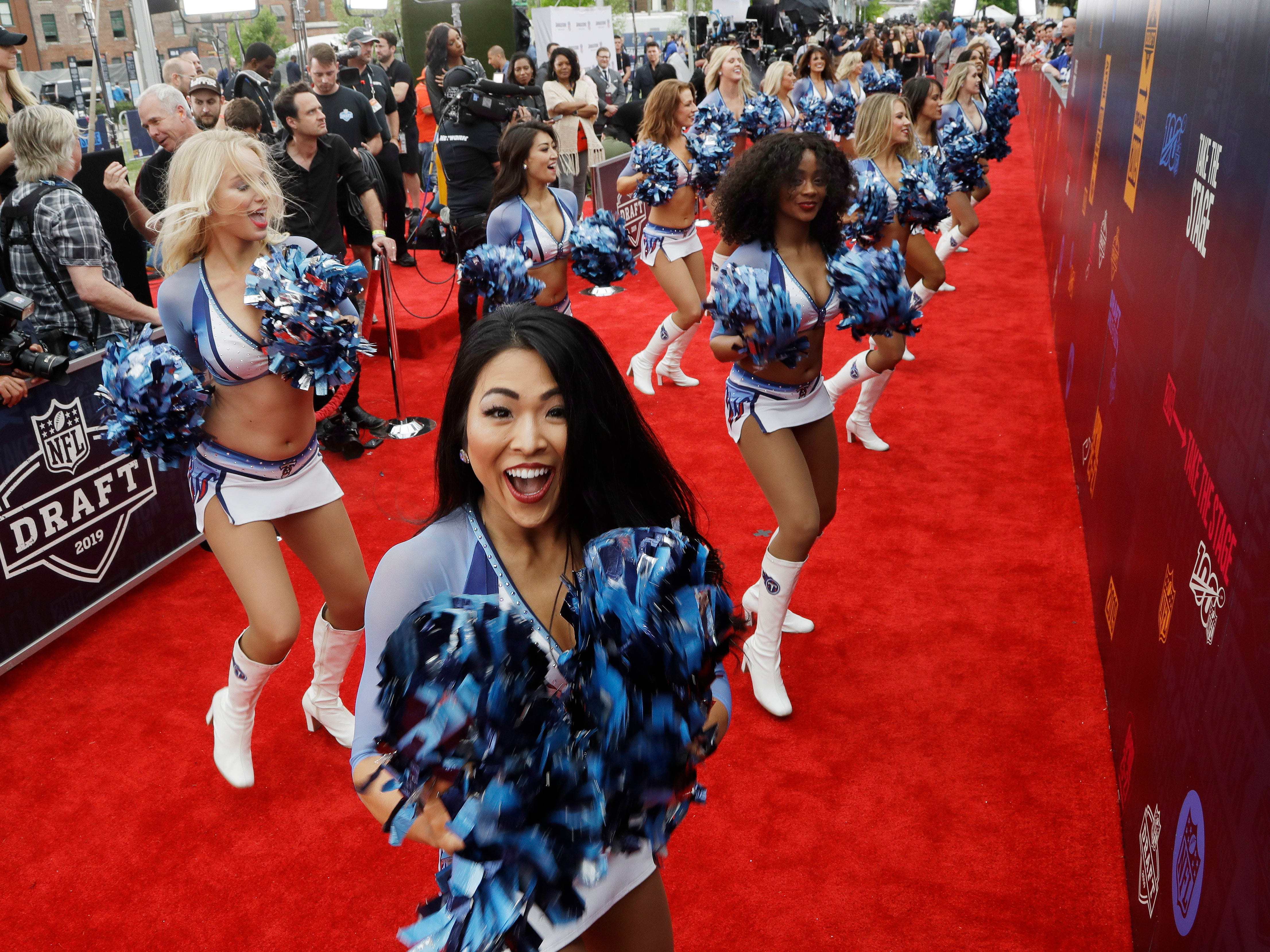 Tennessee Titans cheerleaders perform on the red carpet ahead of the first round of the draft.