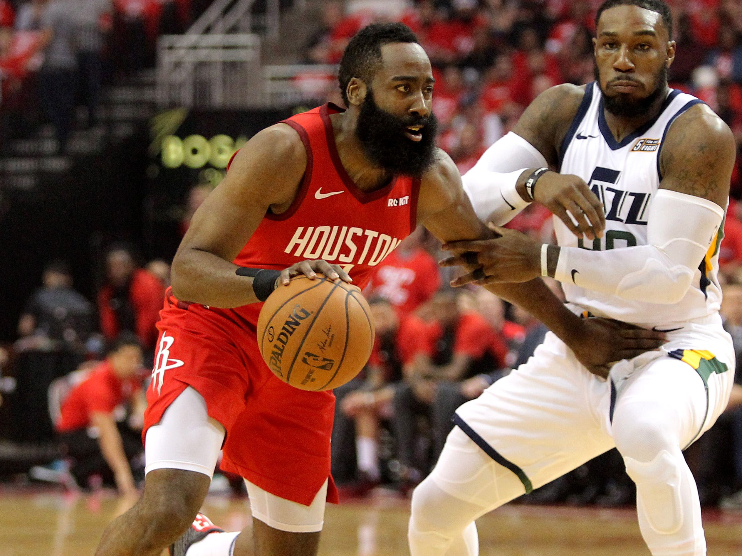 April 24: Rockets guard James Harden (13) looks to drive against Jazz defender Jae Crowder (99) during Game 5 in Houston.