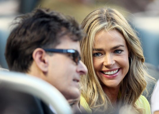 """Denise Richards worries that co-parenting with her ex-husband, Charlie Sheen, exposed their daughters to too much """"dysfunction."""""""