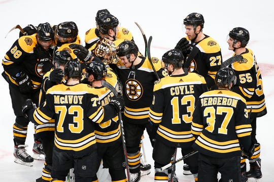 The Boston Bruins celebrate after defeating the Toronto Maple Leafs in Game 7 of their first-round series.