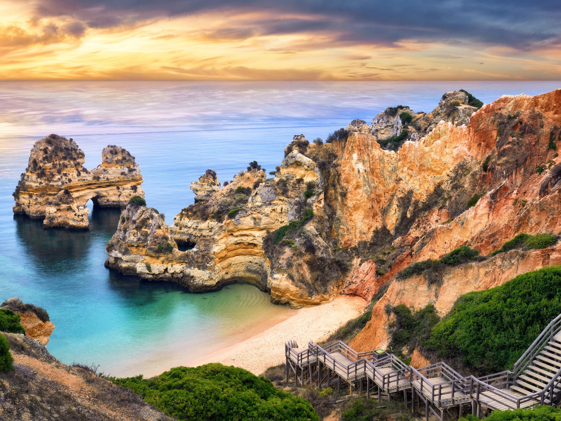 Camilo Beach, Lagos, Portugal: Some of Europe's best beaches are in Portugal's Algarve Region, where white-sand beaches, rocky cliffs and brightly colored fishing towns echo Italy's Amalfi Coast. In the beach town of Lagos, descend the wooden steps to Camilo Beach (or Praia Camilo) for a day of lounging on soft sand and exploring stone arches in the sea cliffs. Switch into adventure mode by booking a boat tour of the bay that can bring you into the nearby grottoes and sea caves that drain at low tide.