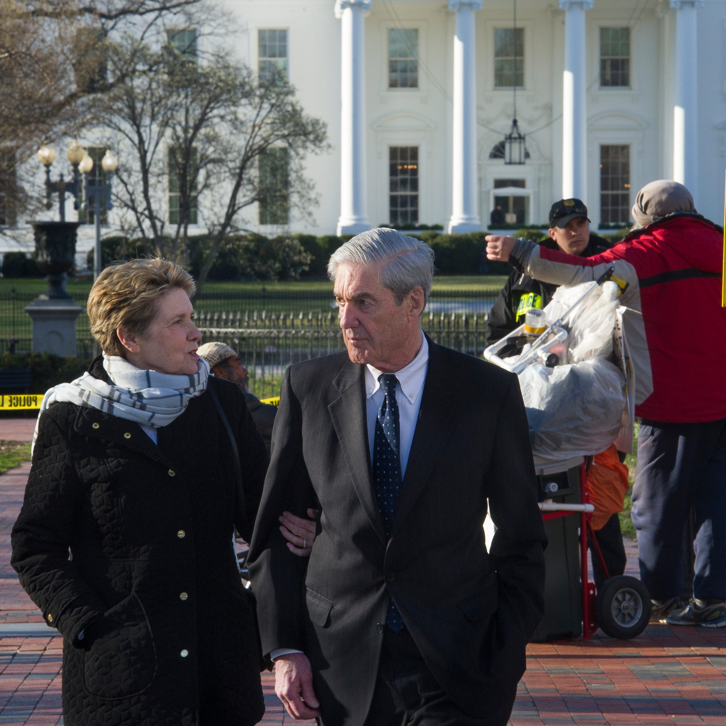 Special Counsel Robert Mueller, and his wife Ann, walk past the White House, to St. John's Episcopal Church for morning services, March 24, 2019 in Washington. Mueller closed his long and contentious Russia investigation with no new charges, ending the probe that has cast a dark shadow over Donald Trump's presidency.