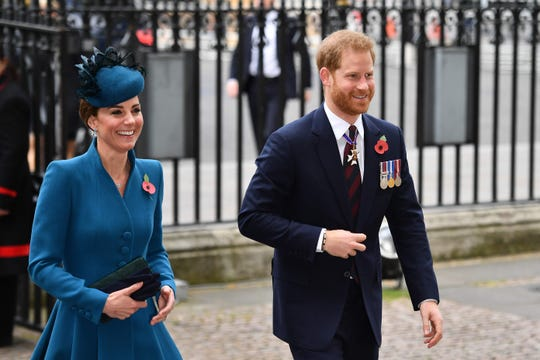 Duchess Kate and Prince Harry enter Westminster Abbey on Thursday.