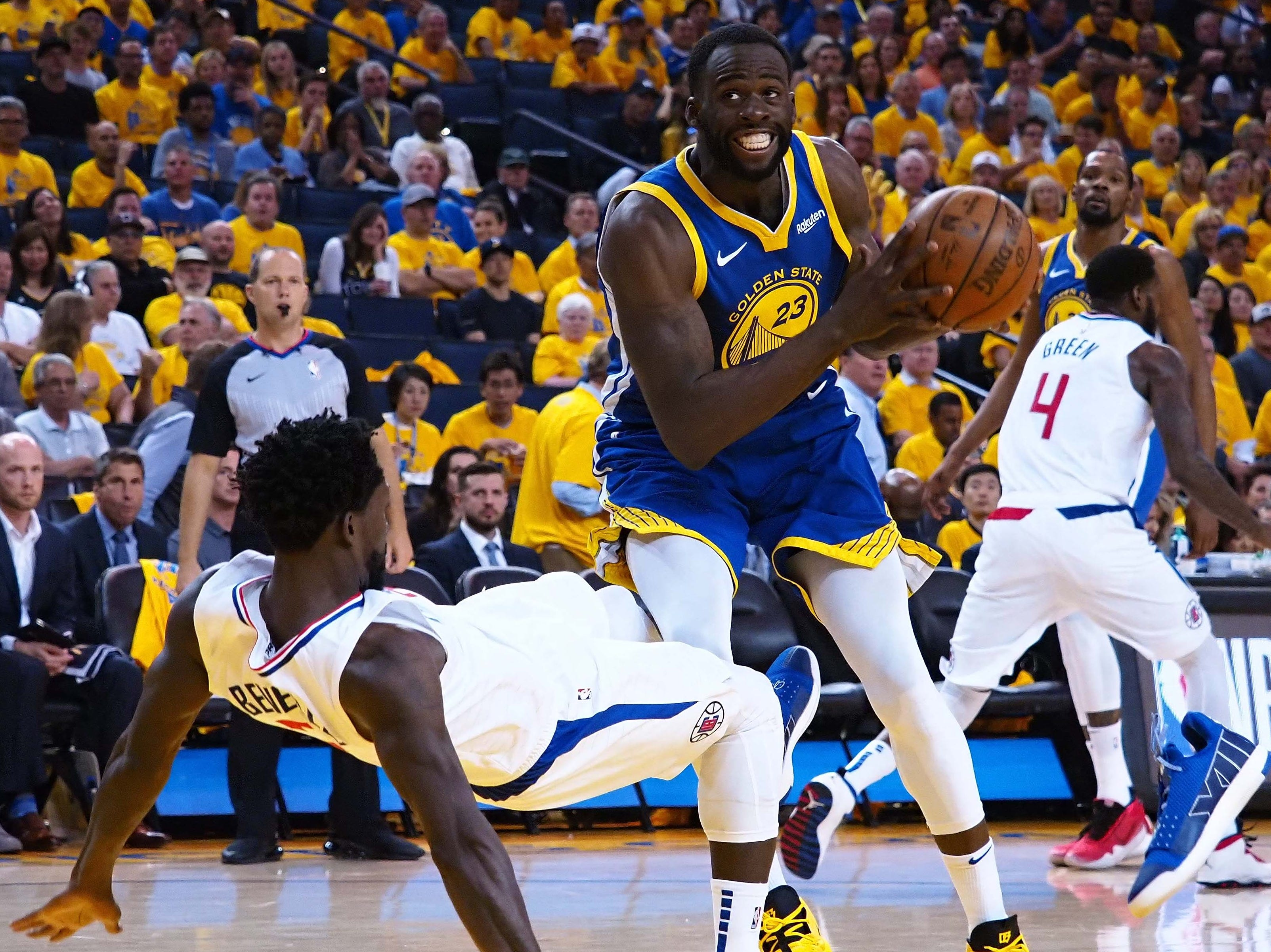 April 24: Clippers defender Patrick Beverley (21) draws a charge against Warriors forward Draymond Green (23) during Game 5.