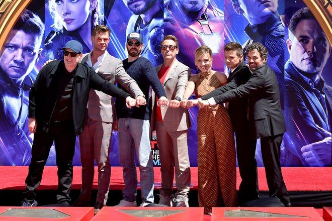 """In this file photo, Marvel Studios president Kevin Feige poses with """"Avengers"""" stars Chris Hemsworth, Chris Evans, Robert Downey Jr., Scarlett Johansson, Jeremy Renner and Mark Ruffalo."""