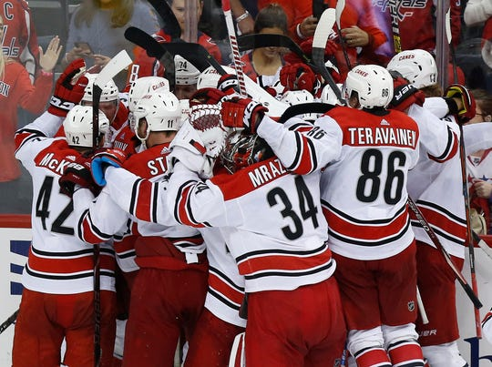 The Carolina Hurricanes celebrate their Game 7 win that knocked off the defending champion Washington Capitals.
