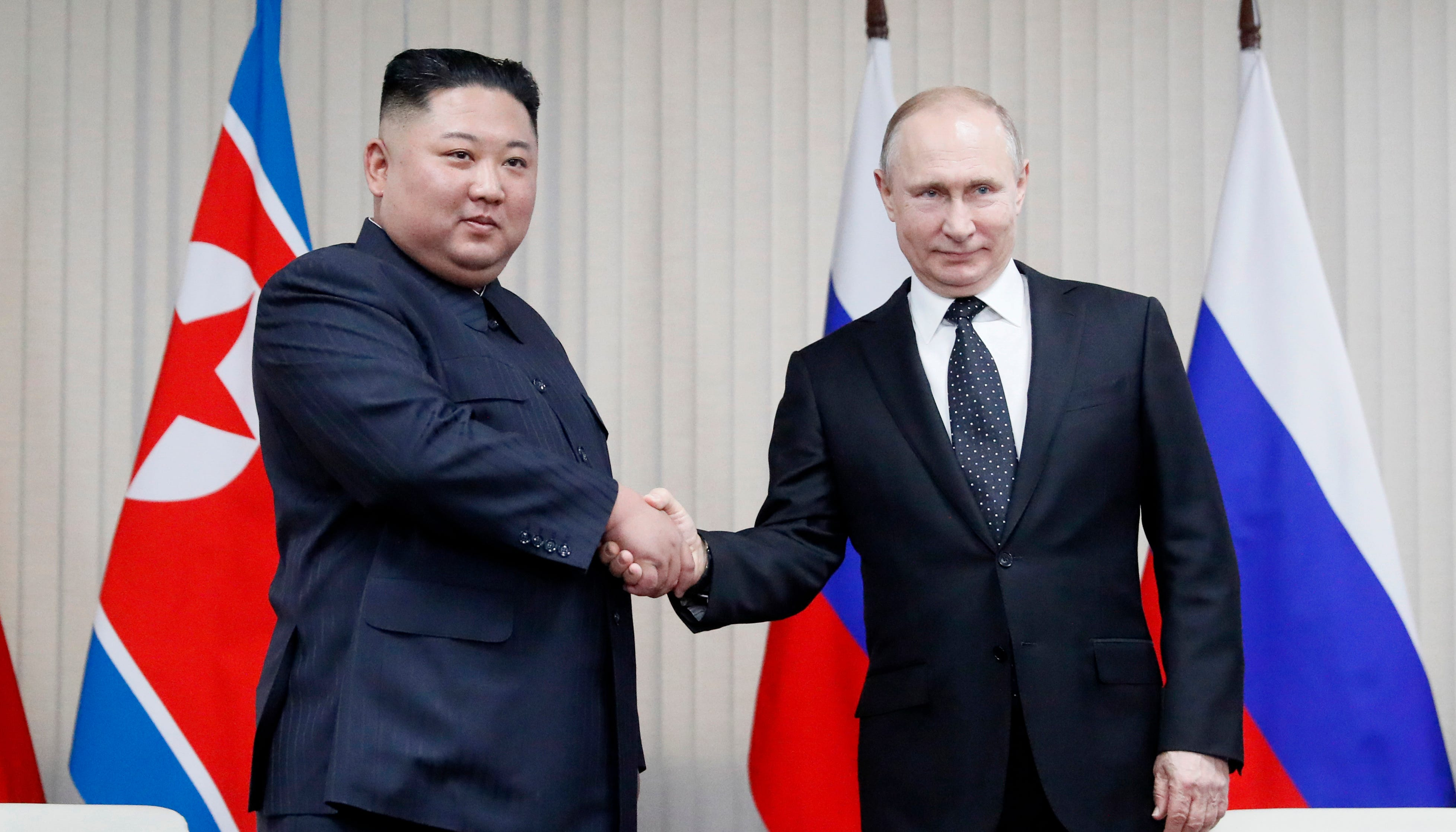 Russian President Vladimir Putin, right, and North Korea's leader Kim Jong Un shake hands during their meeting on Thursday in Vladivostok, Russia.