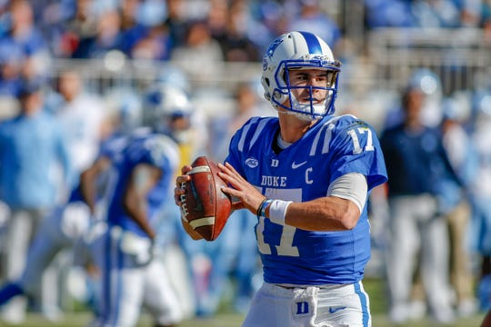 Duke Blue Devils quarterback Daniel Jones looks to pass against the North Carolina Tar Heels in the first half at Wallace Wade Stadium.