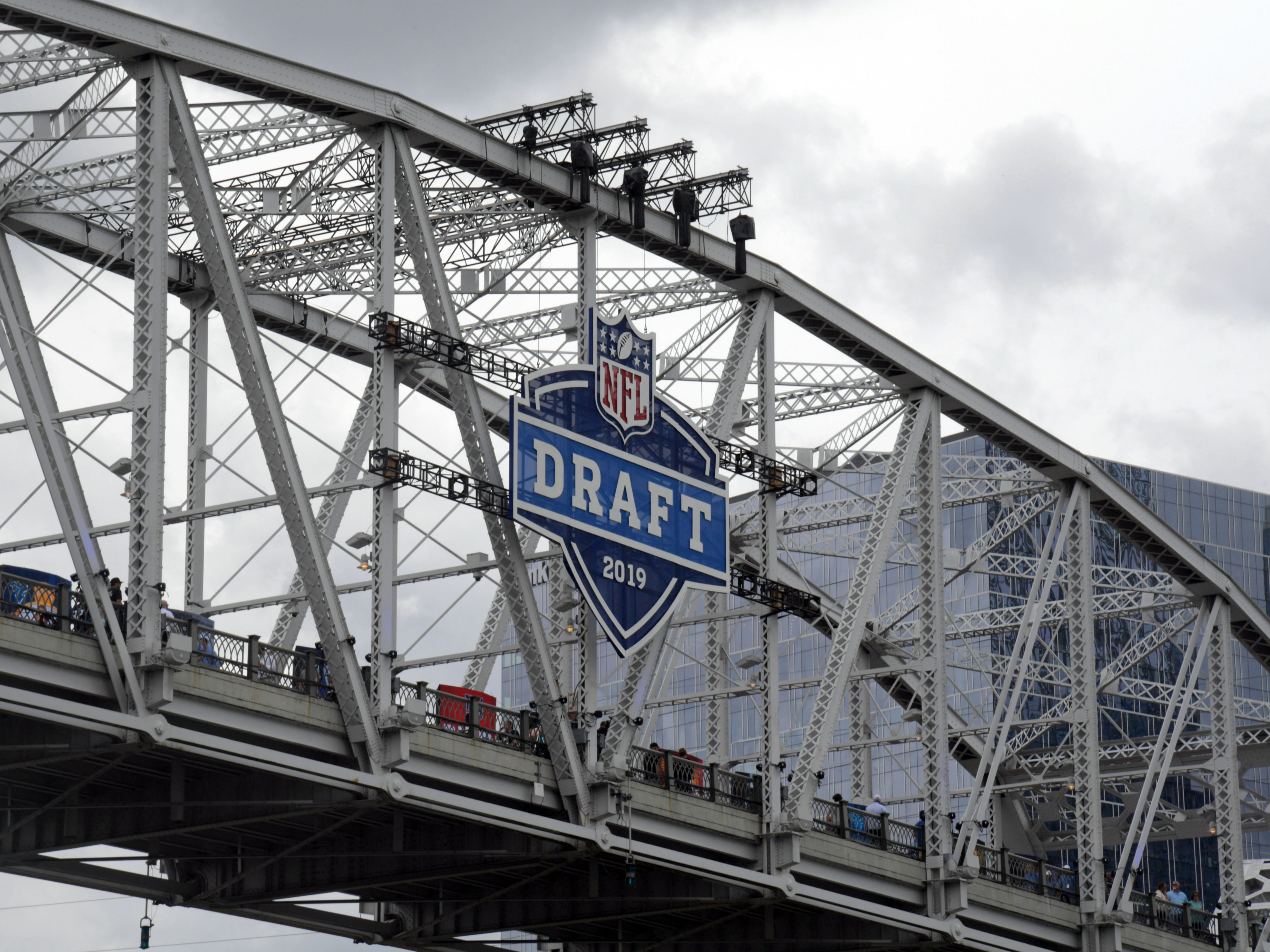 An earlier caption misidentified the name of the bridge shown in this photo. It is the John Seigenthaler Pedestrian Bridge. The John Seigenthaler Pedestrian Bridge is seen with the NFL Draft logo prior to the first round of the 2019 NFL draft.