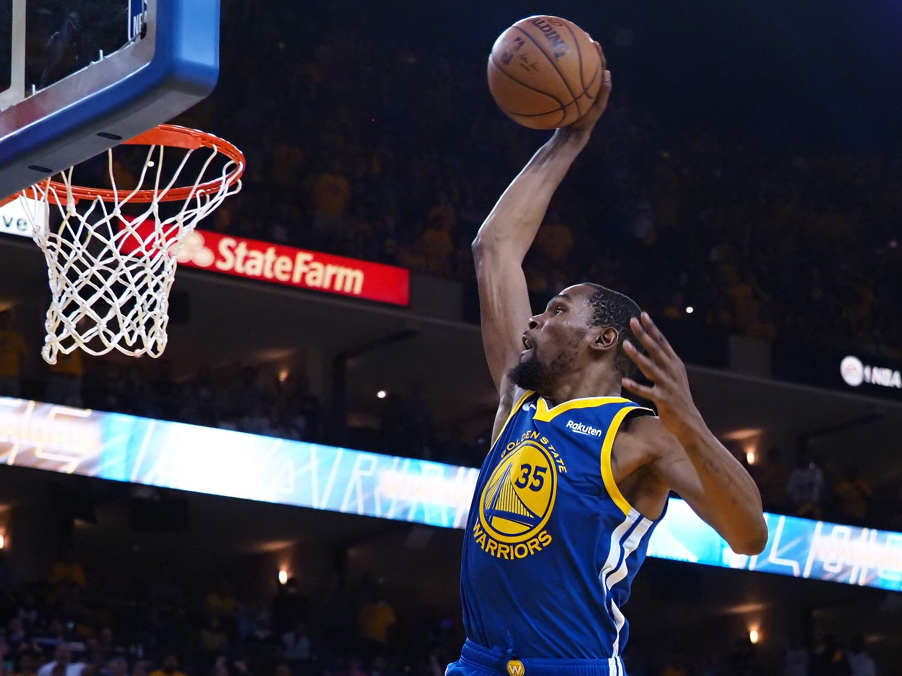 April 24: Warriors forward Kevin Durant glides to the bucket for the one-handed slam during Game 5 against the Clippers.