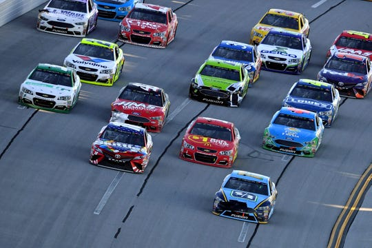 Ricky Stenhouse Jr., front right, leads the field on the last lap of the 2017 GEICO 500 at Talladega Superspeedway, en route to his first career Cup Series win.