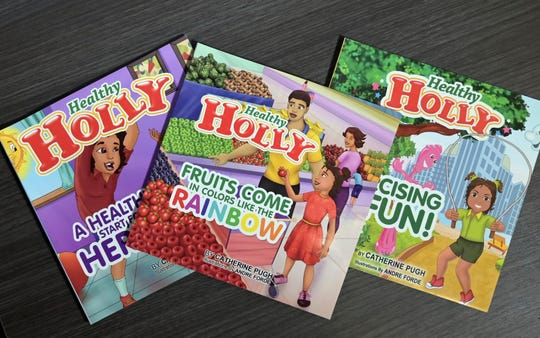 "This March 2019 photo taken in Baltimore, shows copies of Baltimore Mayor Catherine Pugh's self-published ""Healthy Holly"" illustrated paperbacks for children. Baltimore's embattled mayor announced Monday, April 1, that she is taking an indefinite leave of absence, just as a political scandal intensifies over what critics call a ""self-dealing"" book-sales arrangement that threatens her political career."