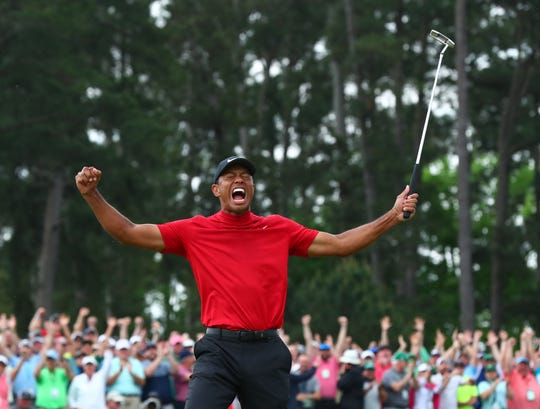 Tiger Woods celebrates after making a putt on the 18th green to win The Masters golf tournament at Augusta National Golf Club in Augusta, Ga. on April 14. 2019.