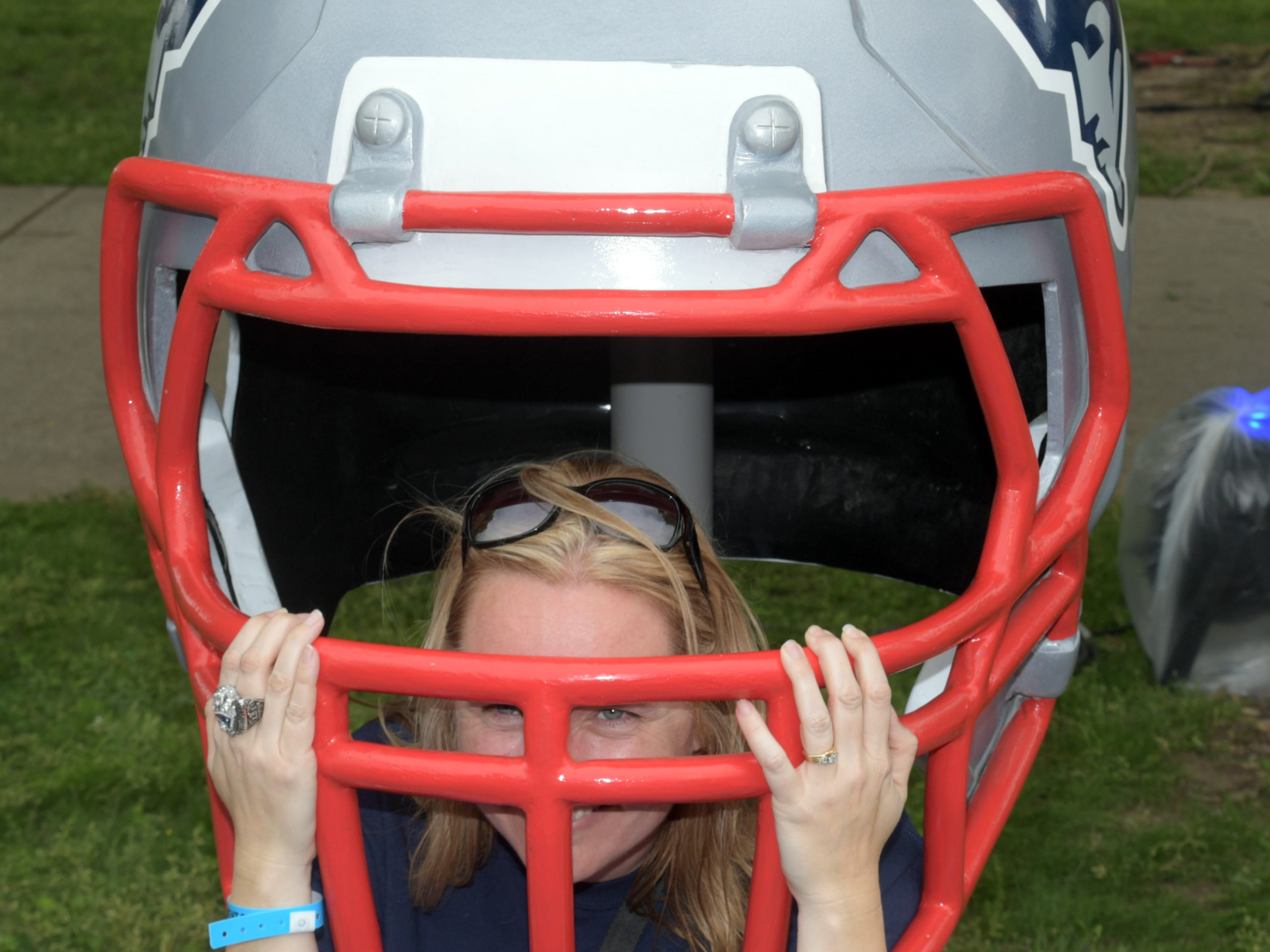 A fan in a giant New England Patriots helmet prior to the first round of the 2019 NFL draft in downtown Nashville.