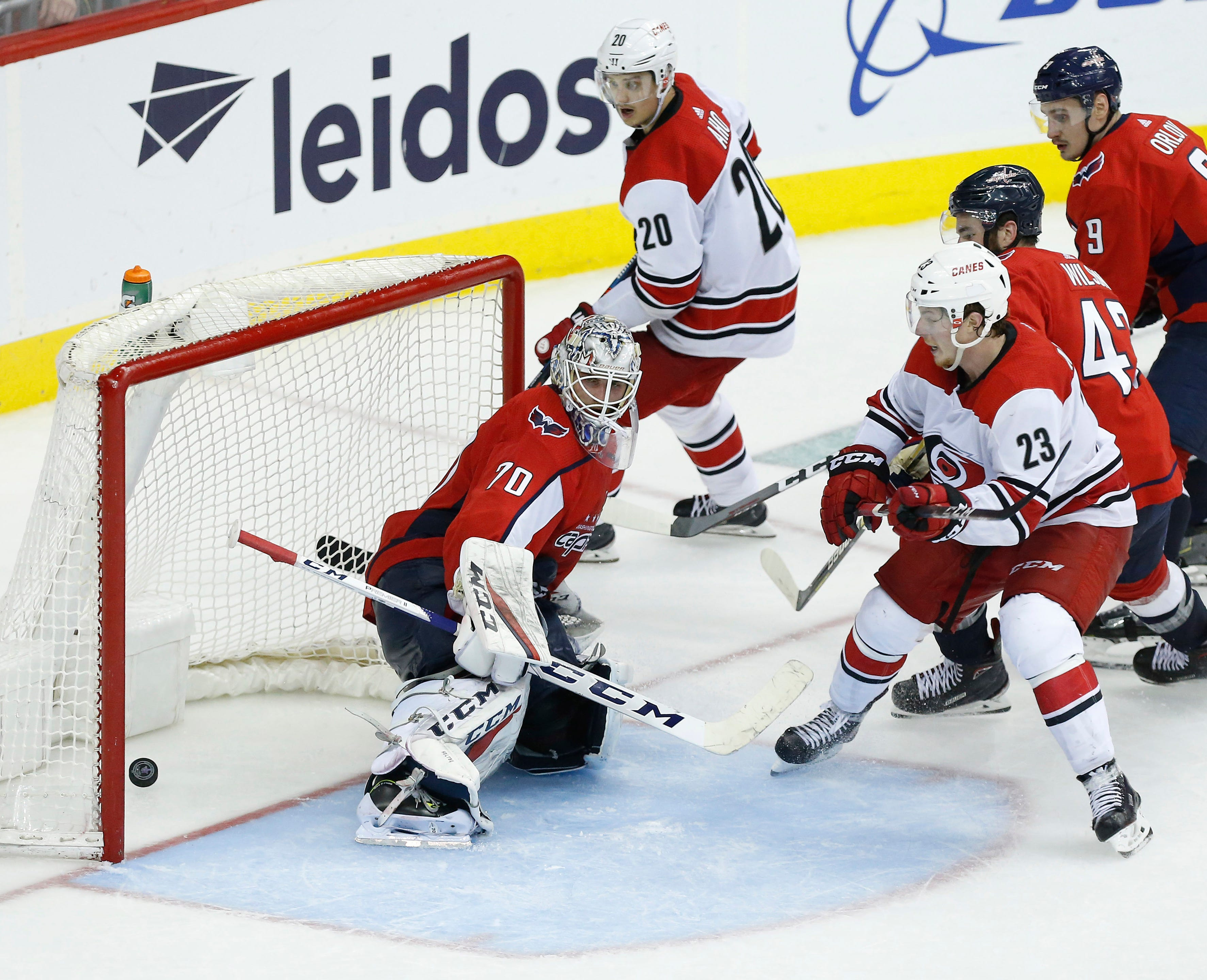 First round: The Carolina Hurricanes' Brock McGinn (23) scores the game-winning goal against the Washington Capitals in the second overtime of Game 7 at Capital One Arena.