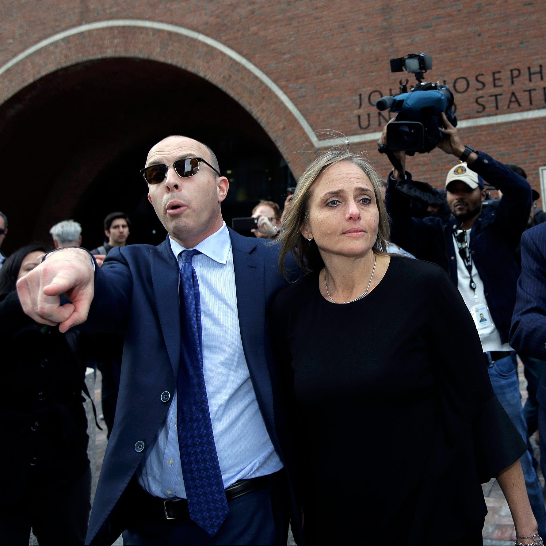 District Court Judge Shelley M. Richmond Joseph, center, departs federal court, Thursday, April 25, 2019, in Boston after facing obstruction of justice charges for allegedly helping a man in the country illegally evade immigration officials as he left her Newton, Mass., courthouse after a hearing in 2018. (AP Photo/Steven Senne) ORG XMIT: BX105