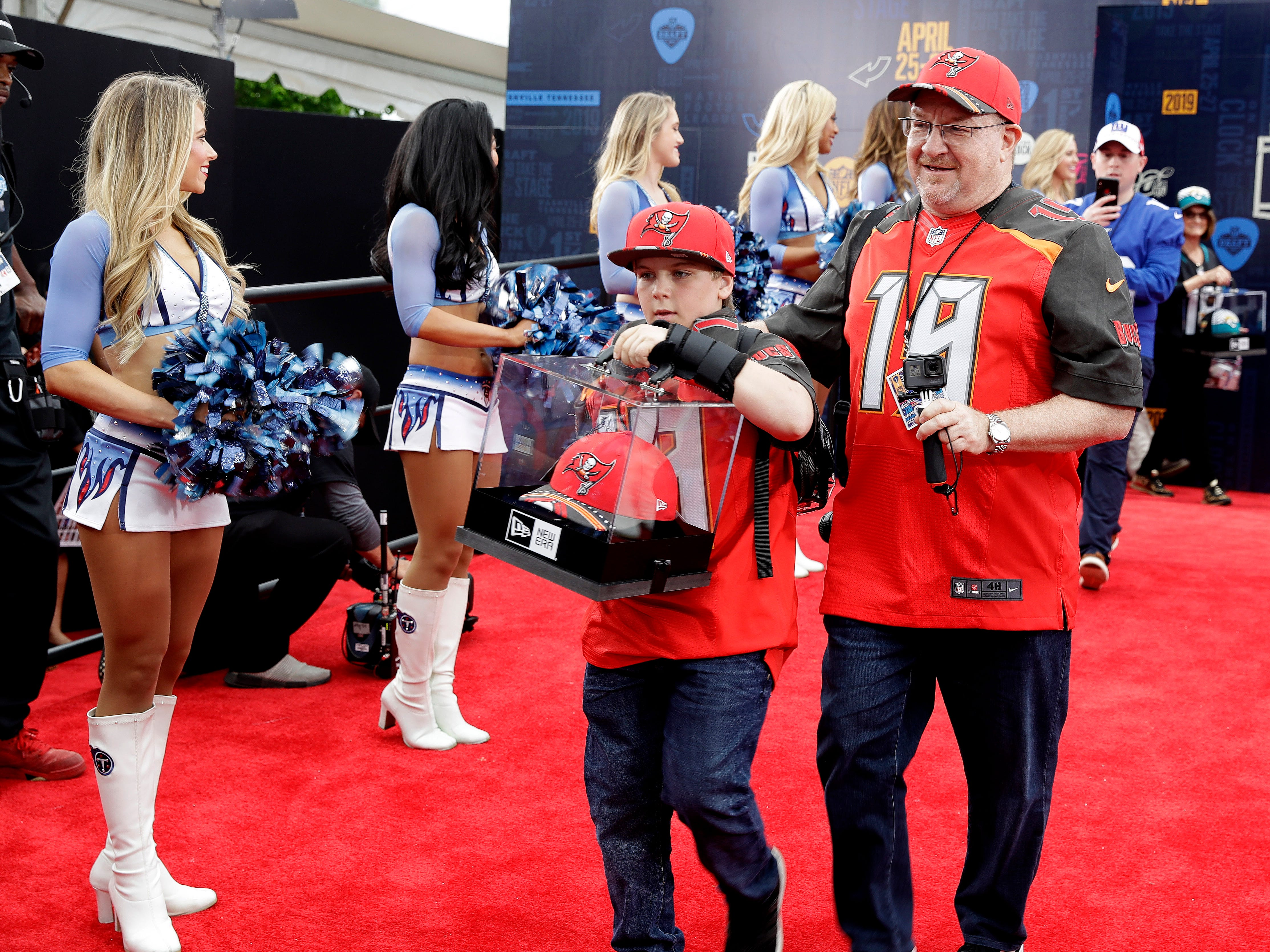 Fans walk the red carpet ahead of the first round of the draft.