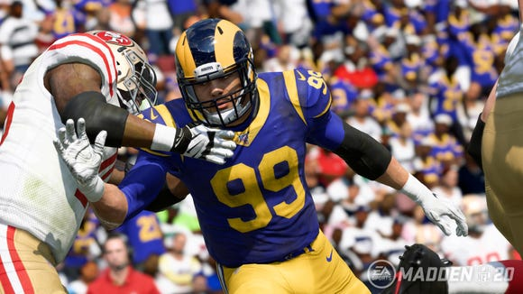 A screenshot from the video game 'Madden NFL 20' shows Los Angeles Rams defensive tackle Aaron Donald.