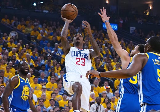 April 24: Clippers guard Lou Williams (23) puts up a floater in the lane during Game 5 against the Warriors in Oakland.