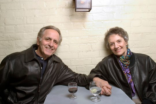"""Mark Medoff, left, and actress Phyllis Frelich pose for a photo in New York. Medoff, who wrote the award-winning play """"Children of a Lesser God,"""" has died in New Mexico at age 79."""