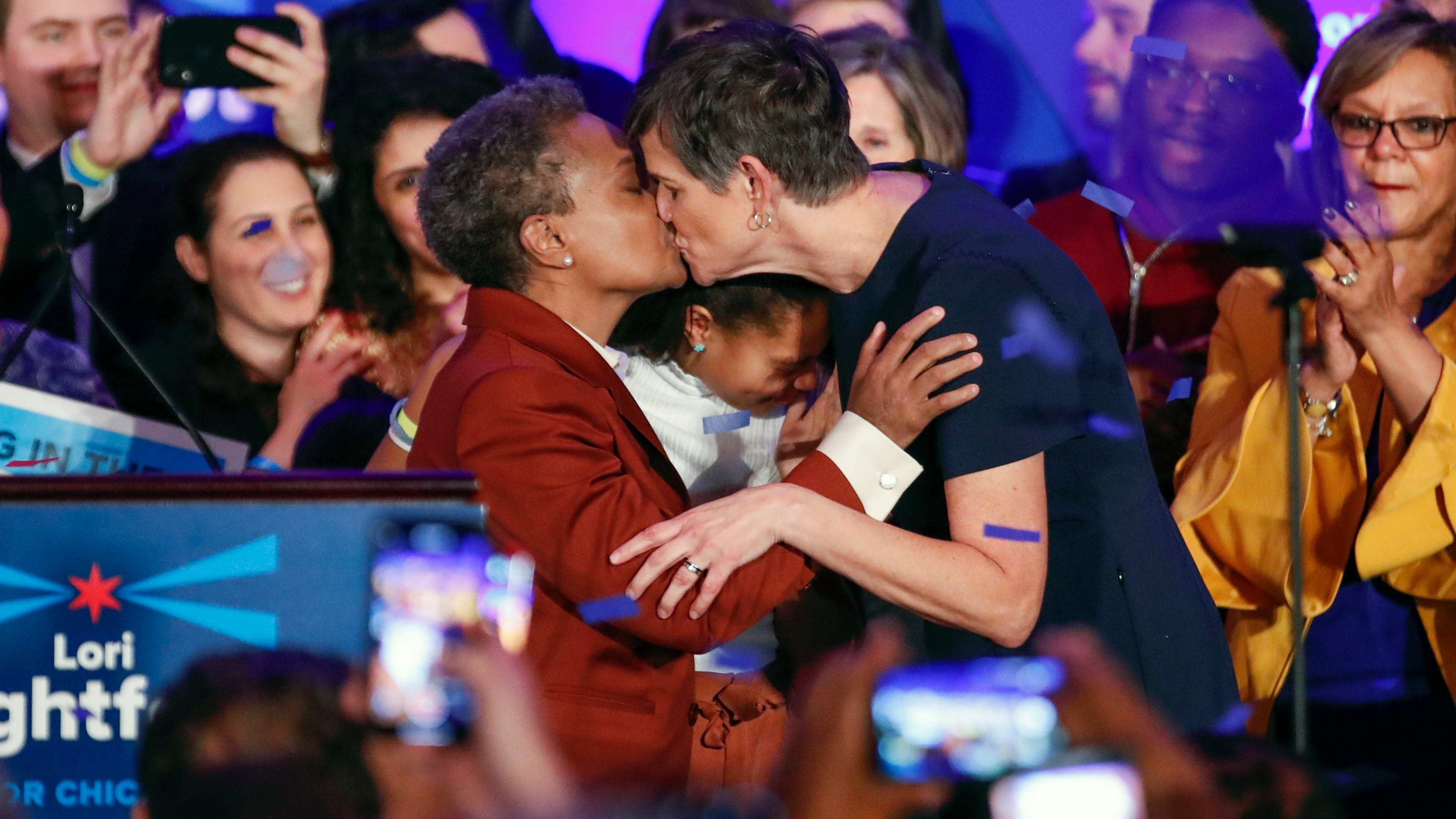 Chicago mayor elect Lori Lightfoot (L) kisses wife Amy Eshleman after speaking during the election night party in Chicago on April 2, 2019. In a historic first, a gay African American woman was elected mayor of America's third largest city as Chicago voters entrusted a political novice with tackling difficult problems of economic inequality and gun violence.