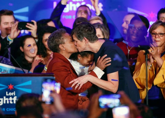 Chicago mayor elect Lori Lightfoot (L) kisses wife Amy Eshleman after speaking during her election night party in Chicago on April 2, 2019. In a historic first, a gay African American woman was elected mayor of America's third-largest city.