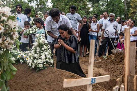 A woman grieves at the grave after a funeral for a person killed in the Easter Sunday attack on St Sebastian's Church, on April 25, 2019 in Negombo, Sri Lanka. At least 359 people were killed and 500 people injured after coordinated attacks on churches and hotels on Easter Sunday which rocked three churches and three luxury hotels in and around Colombo as well as at Batticaloa in Sri Lanka.