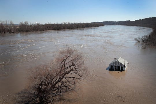 "A structure is surrounded by floodwater on March 21, 2019 in Atchison, Kansas. Several Midwest states are battling some of the worst flooding they have experienced in decades as rain and snow melt from the recent ""bomb cyclone"" has inundated rivers and streams. At least three deaths have been linked to the flooding."
