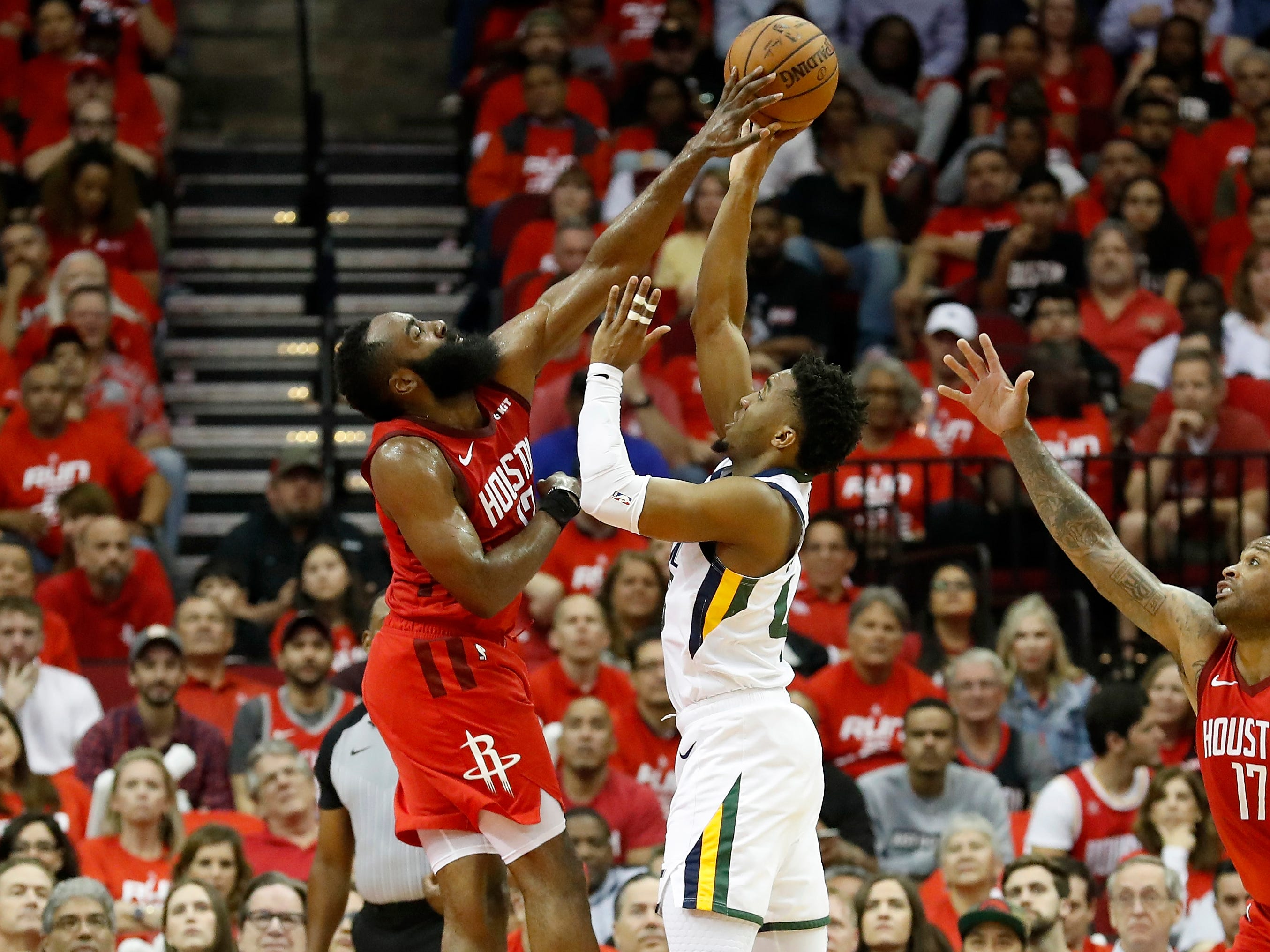 April 24: Rockets defender James Harden (13) blocks a shot attempt by Jazz guard Donovan Mitchell (45) during Game 5.