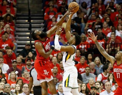 April 24: Rockets defender James Harden (13) blocks a shot attempt by Jazz guard Donovan Mitchell (45) during Game 5.