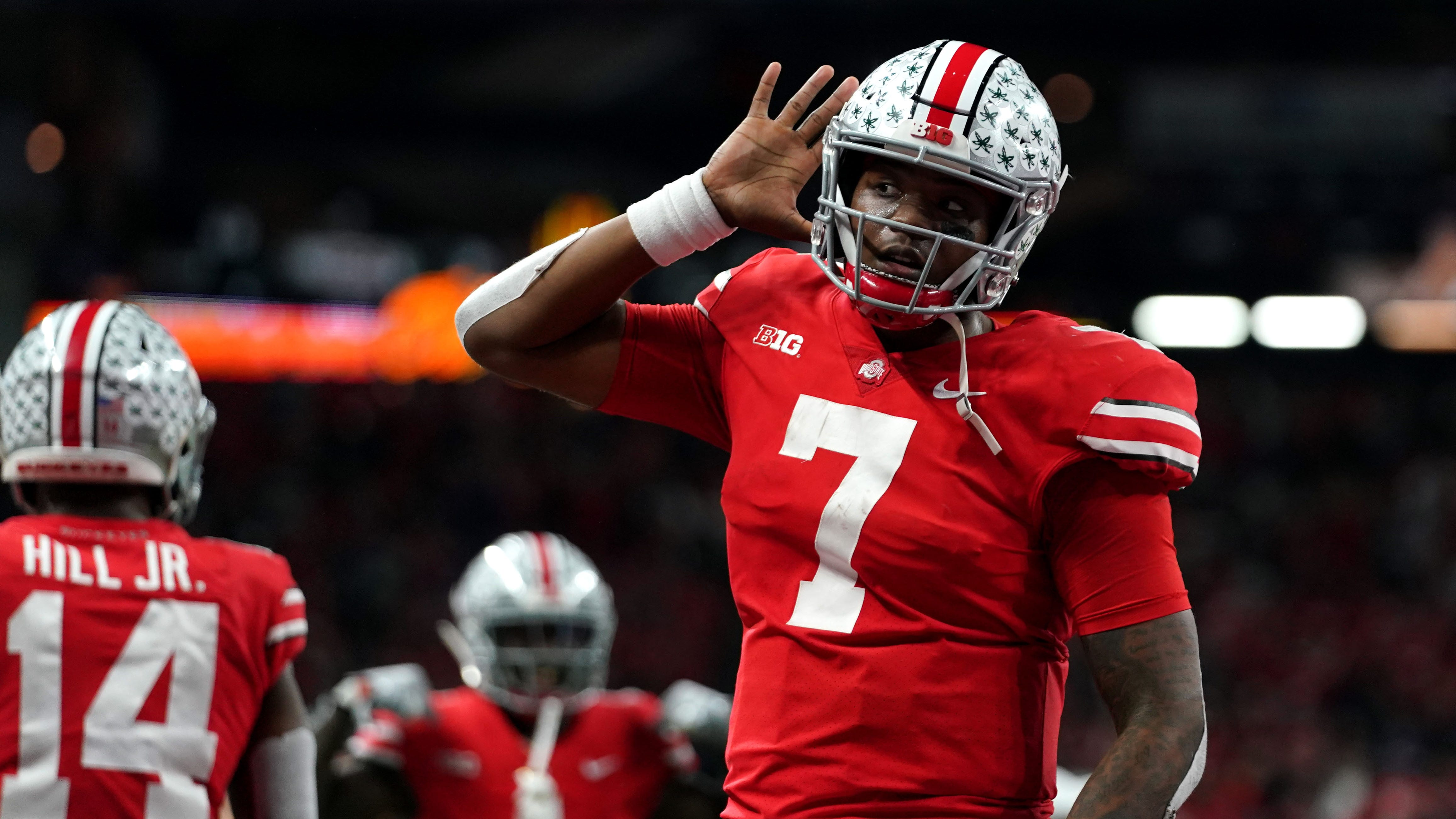 Ohio State Buckeyes quarterback Dwayne Haskins (7) celebrates with teammates after throwing a touchdown pass against the Northwestern Wildcats in the first half in the Big Ten conference championship game at Lucas Oil Stadium.