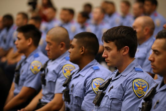 San Francisco police recruits look on during a news conference at the San Francisco Police Academy on May 15, 2018.