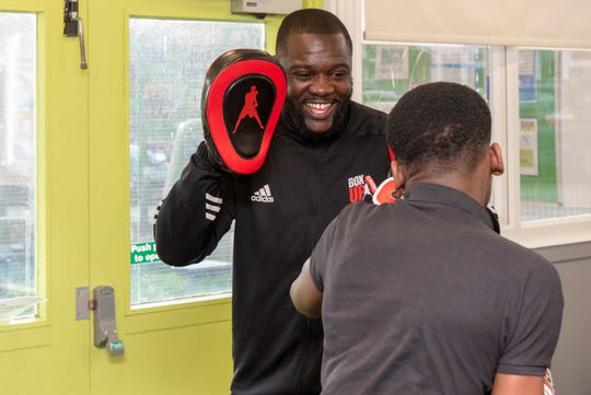 Stephen Addison, left, works out at BoxUp Crime, the organization he founded to help stem violence among Britain's youth.