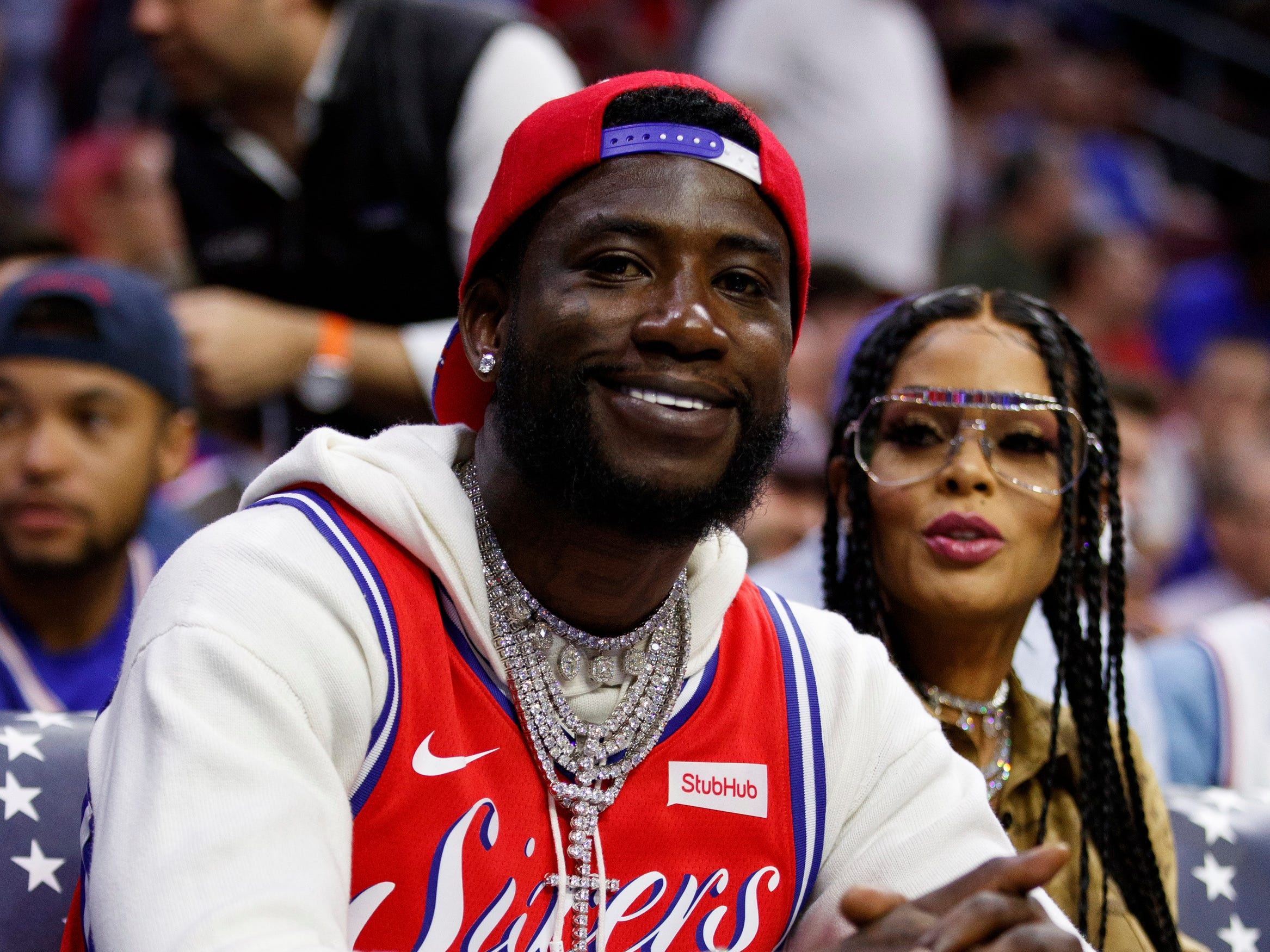 April 23: Rapper Gucci Mane and model Keyshia Ka'oir Davis look on during Game 5 between the 76ers and Nets in Philadelphia.
