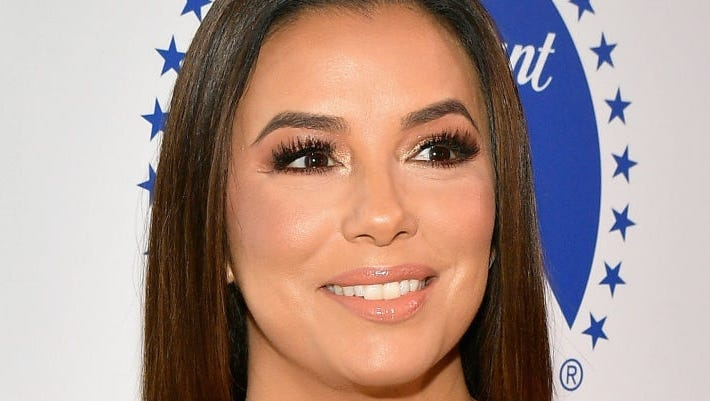 Eva Longoria shared some photos from her beach vacation of herself in bikini 10 months after giving birth to her son.