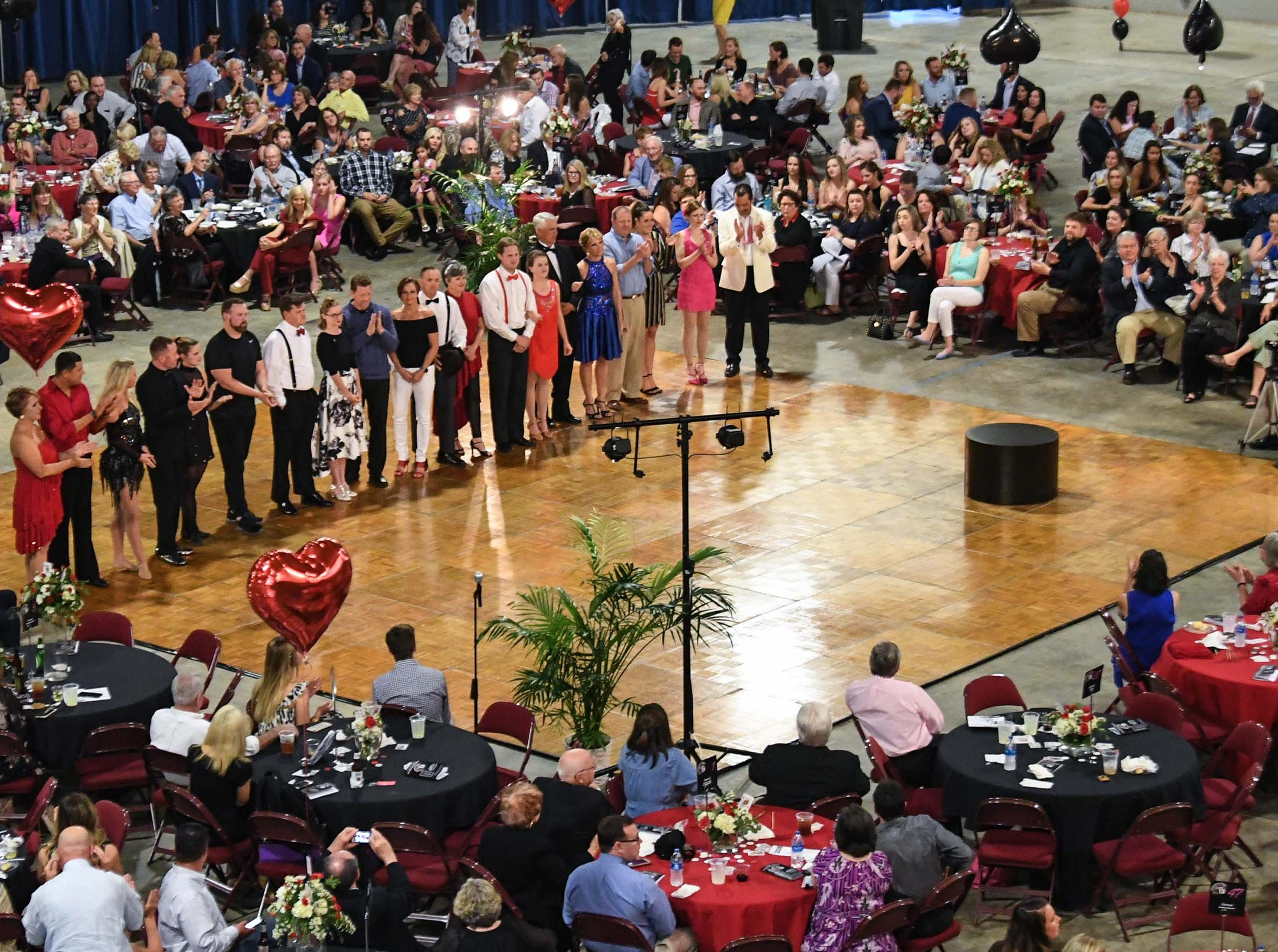 "The ten dance couples are introduced during the 13th Dancing For Our Heroes event with the theme ""Welcome to Las Vegas"" at the Civic Center of Anderson Thursday. The ten dance couples raised money for different charities, dancing to acts who have residencies in Las Vegas."