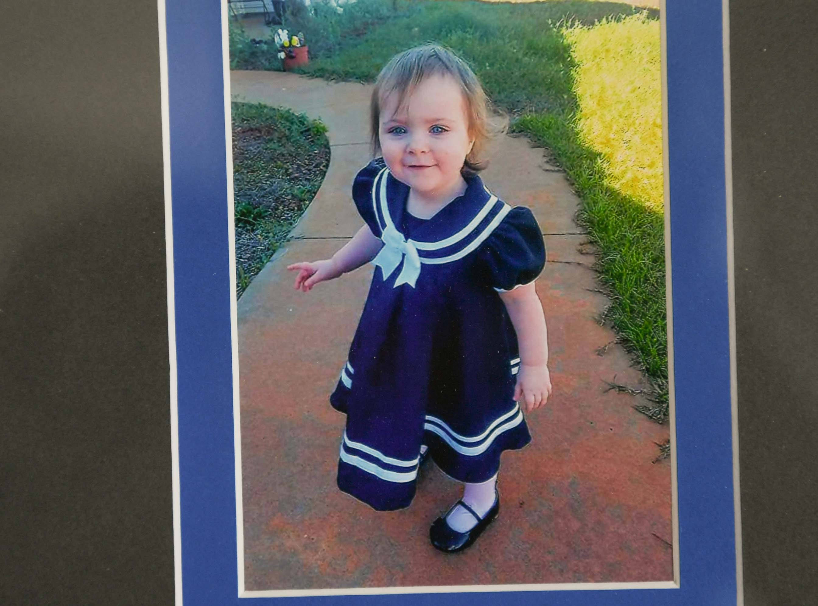 "A framed photo of the late Gwynne Ann-Marie Hess, before an office dedication of the Foothills Alliance Oconee County Gwynnie Bee House in Walhalla Friday. Foothills Alliance, who with partners provides education, advocacy, and treatment services to prevent sexual assault trauma and child abuse services in Anderson and Oconee Counties, branched out from their Anderson office with an office in Walhalla last August. Gwynne Ann-Marie Hess, ""Gwynnie Bee, died in 2017 from child abuse, and the office was renamed after her Friday in the presence of family, law enforcement, Sen. Thomas Alexander, Oconee County Sheriff Michael Crenshaw, and Tenth Circuit Solicitor David Wagner."