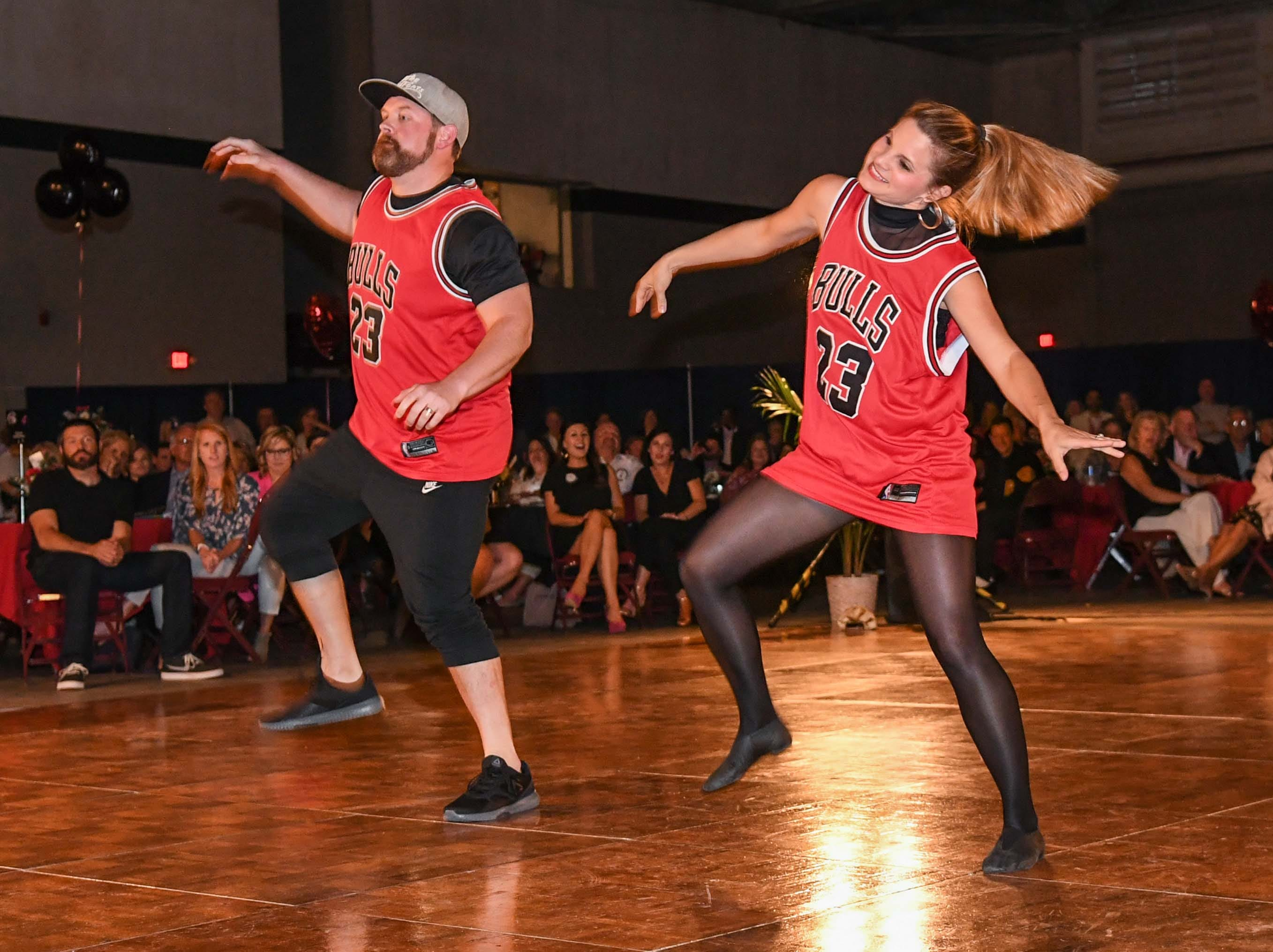 "Dr. J.P. Stokes, left, and Catherine Walker Zocchi dance to a medley of songs by the Backstreet Boys during the 13th Dancing For Our Heroes event with the theme ""Welcome to Las Vegas"" at the Civic Center of Anderson Thursday. The dance couple raised money for Hospice of the Upstate. The ten dance couples raised money for different charities, dancing to acts who have residencies in Las Vegas."